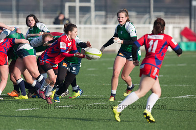 Lena Auriol offloads the ball as she is tackled by Laura Di Muzio