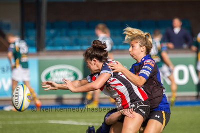 Fee Bowen gets a pass away as she is double tackled