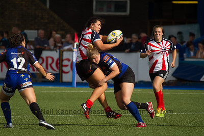 Shona Powell Hughes being tackled