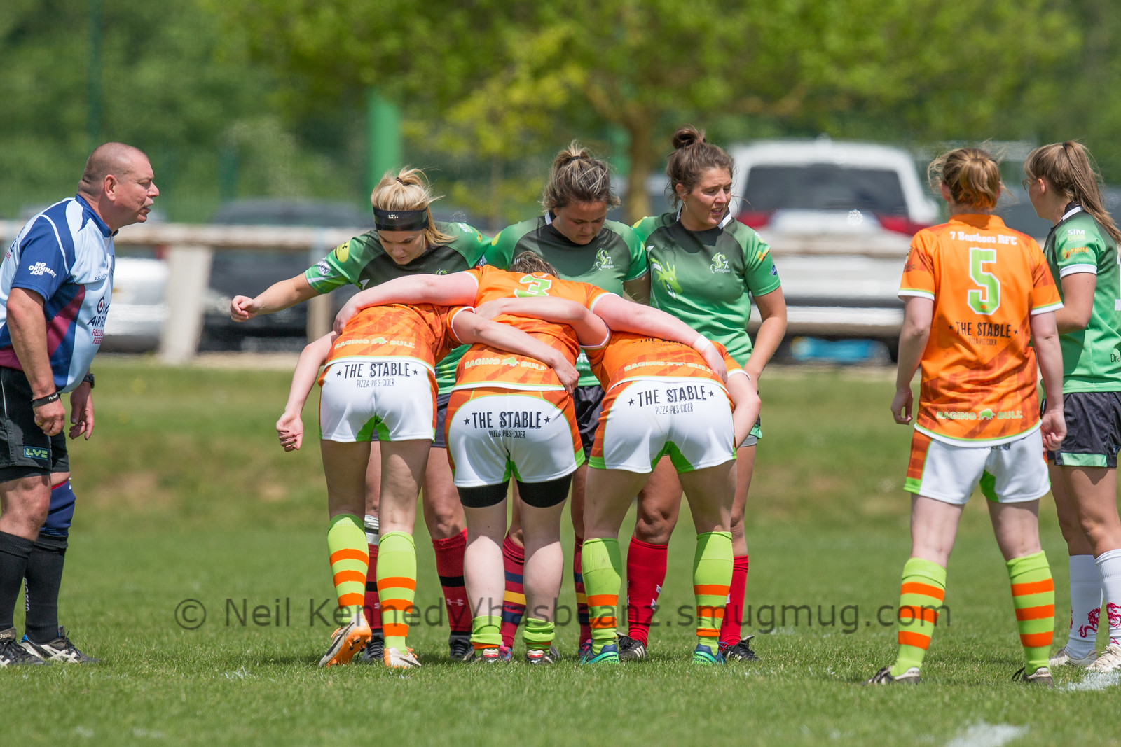 Rhiannon Mann, Georgia Bradley and Kathryn Salter prepare for a scrum