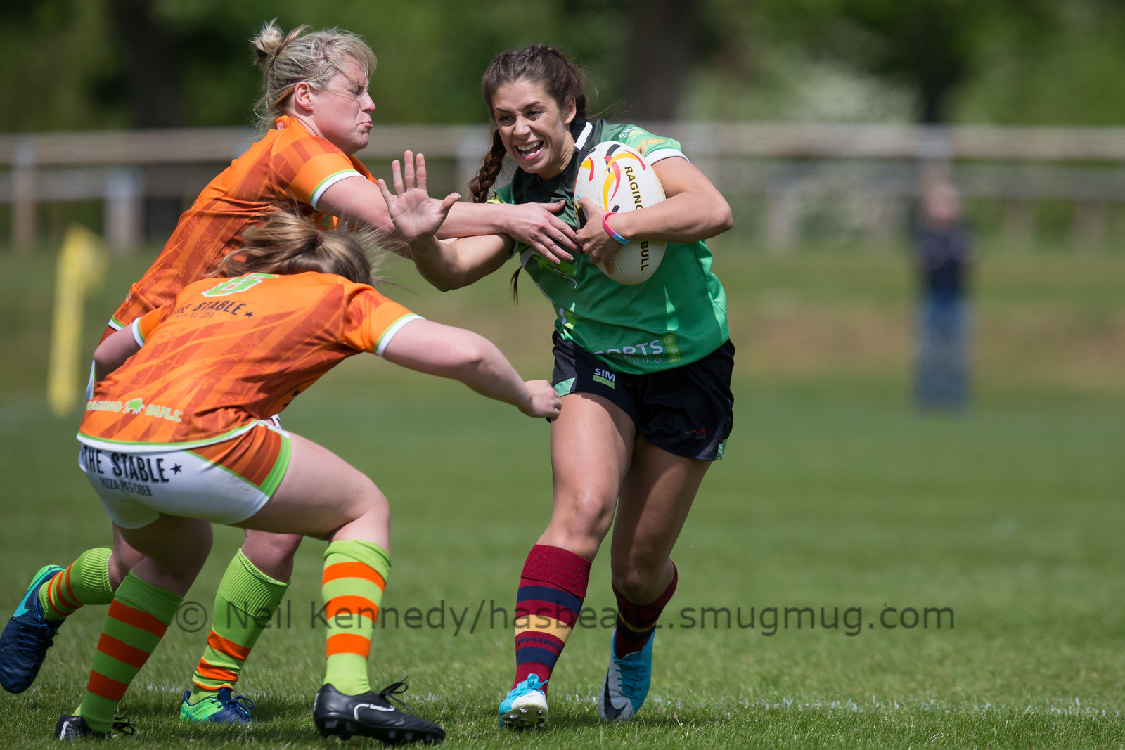 Daisey Mayes fends a tackle