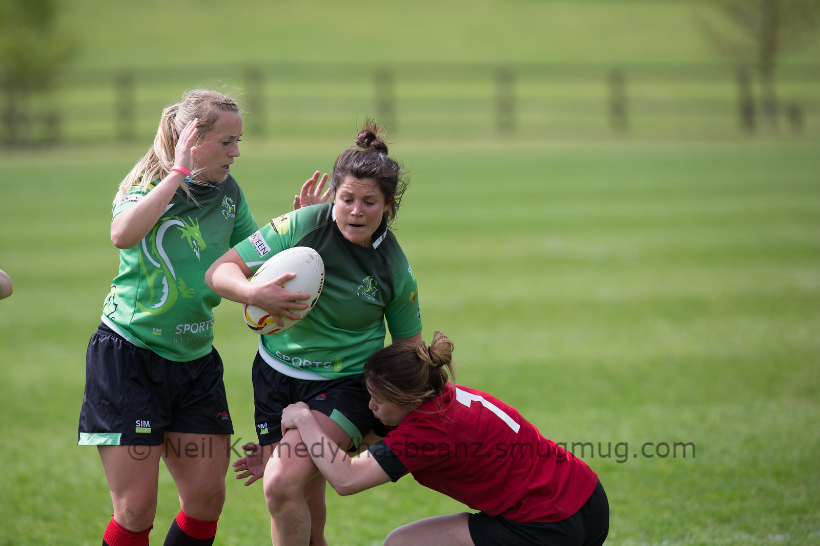 Annabelle Semmence  with the ball fending a tackle