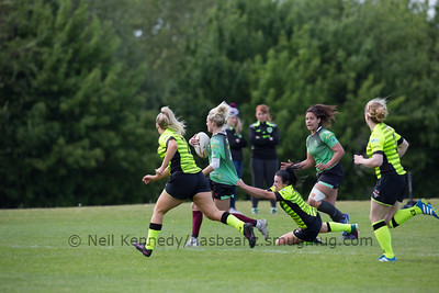 Robyn Pinder with the ball is dragged back by Brittony Price