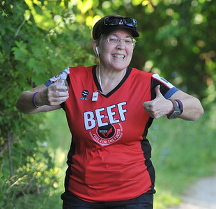 Jill Seltzer is all smiles druing the 5K run as part of the Rochester Run Michigan Cheap event  held on Sunday July 16, 2017.  Over 170 entrants took part in the 5K, 10K and 1/2 marathons that were run on the Paint Creek Trail starting in Lake Orion.  (Digital First Media photo by Ken Swart)