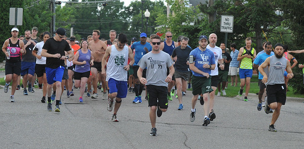 And they're off.  Over 170 entrants took part in the Rochester Run Michigan Cheap event held on Sunday July 16, 2017.  The 5K, 10K and 1/2 marathons were run on the Paint Creek Trail starting in Lake Orion.  (Digital First Media photo by Ken Swart)
