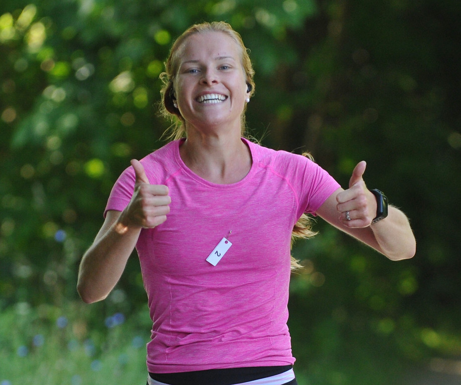 . Abigail Wrobel gives two thumbs up during her 5K run as part of the Rochester Run Michigan Cheap event held on Sunday July 16, 2017.  The 5K, 10K and 1/2 marathon runs were run on the Paint Creek Trail starting in Lake Orion.  (Digital First Media photo by Ken Swart)