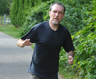 Thierry Boulic from Troy, makes his way to the finish of the half marathon as part of the Rochester Run Michigan Cheap event held on Sunday July 16, 2017.  The 5K, 10K and 1/2 marathons were run on the Paint Creek Trail starting in Lake Orion.  (Digital First Media photo by Ken Swart)