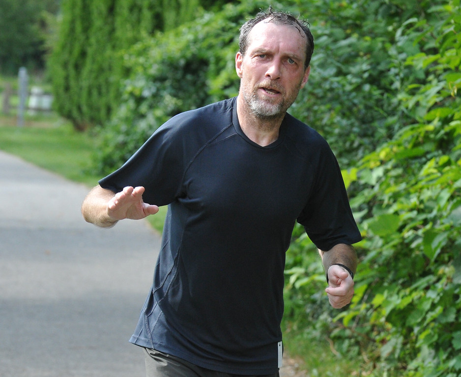 . Thierry Boulic from Troy, makes his way to the finish of the half marathon as part of the Rochester Run Michigan Cheap event held on Sunday July 16, 2017.  The 5K, 10K and 1/2 marathons were run on the Paint Creek Trail starting in Lake Orion.  (Digital First Media photo by Ken Swart)