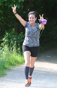Marianna Martinez of Troy runs the 10K as part of the Rochester Run Michigan Cheap event  held on Sunday July 16, 2017.  Over 170 entrants took part in the 5K, 10K and 1/2 marathons that were run on the Paint Creek Trail starting in Lake Orion.  (Digital First Media photo by Ken Swart)