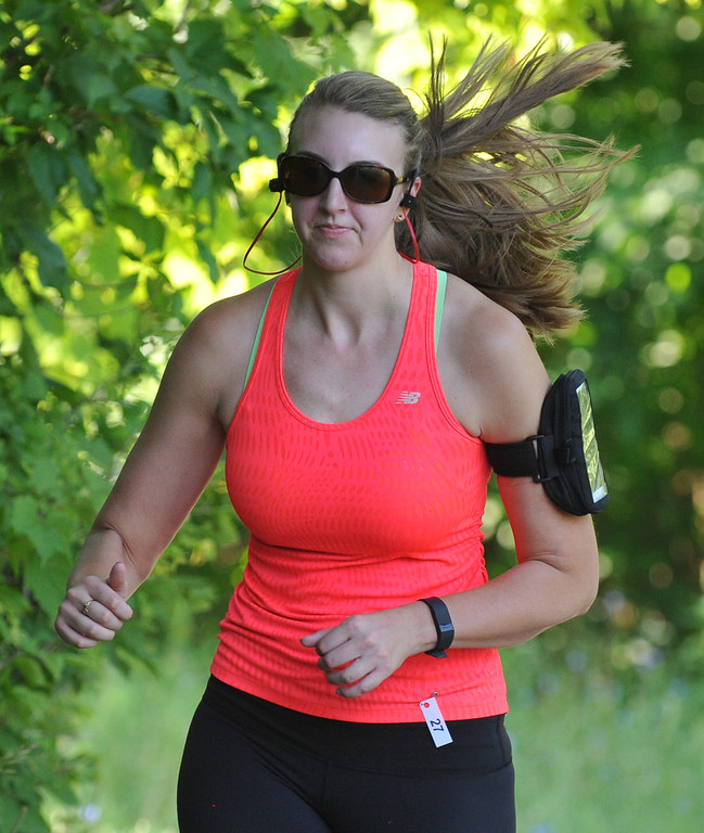 . Caitlin McCourt makes her way down the trial in the 5K run as part of the Rochester Run Michigan Cheap event  held on Sunday July 16, 2017.  Over 170 entrants took part in the 5K, 10K and 1/2 marathons that were run on the Paint Creek Trail starting in Lake Orion.  (Digital First Media photo by Ken Swart)