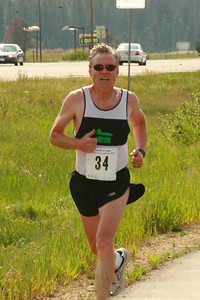 Dennnis Simmons runs in the 60 plus age group.