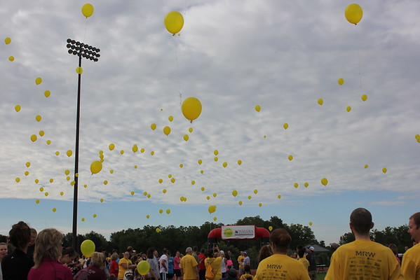 Yellow balloons filled the sky as part of the kick off for the MHP Serenity House Run in the Sun event.