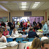 Runners gathering in the Grafton High School cafeteria before the race.  Race start line is outside the far window.