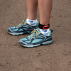 RUSA Webmaster Mary sporting new shoes she won at the Keyes Peak Trail Marathon in Florence, WI back on June 19, 2010