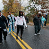 """Leominster High """"zombies"""" approach passing runners during the Running Dead 5K on Saturday afternoon. The Class of 2018 held the event in hopes of reaching their target revenue goal of $2,000. The money will be used to help cover graduation, prom and class gift costs. SENTINEL & ENTERPRISE / Ashley Green"""