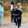 """Leominster High """"zombies"""" approach passing cars during the Running Dead 5K on Saturday afternoon. The Class of 2018 held the event in hopes of reaching their target revenue goal of $2,000. The money will be used to help cover graduation, prom and class gift costs. SENTINEL & ENTERPRISE / Ashley Green"""