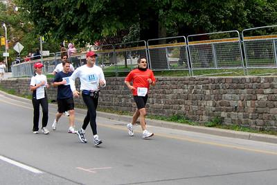 Around the corner of Queen's Park towards the finish of the Toronto Marathon - October 2005