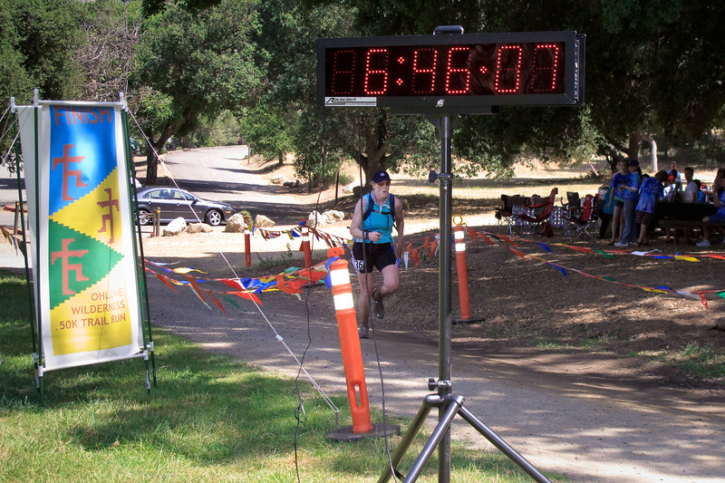 Kathy Davies (36) crosses the finish in 55th place at 6:46:09.