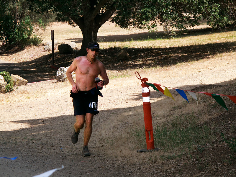 Greg Duff (40) enters the finishing gate in 48th place at 6:38:59.
