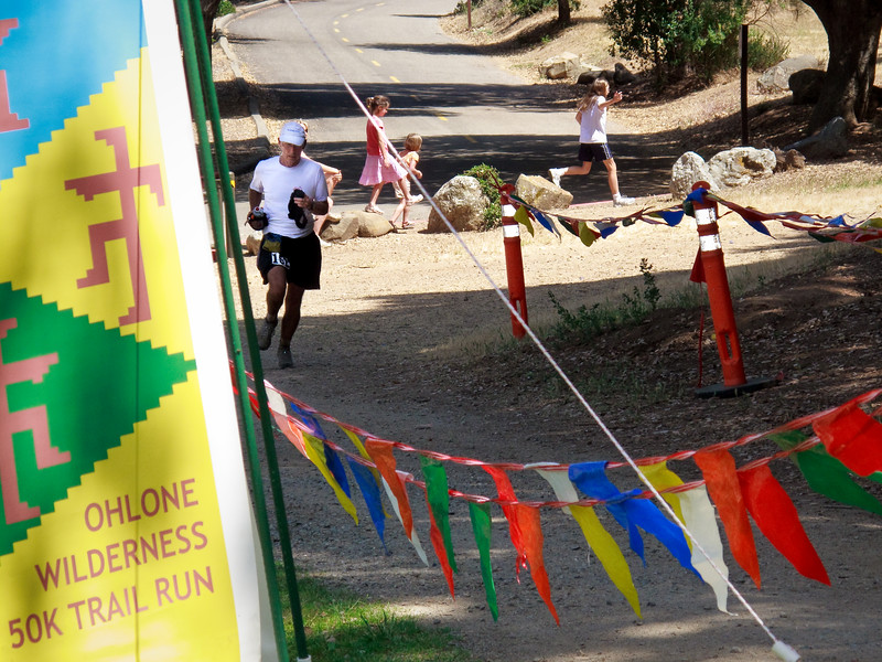 Jim Magill (62) enters the finishing gate in 59th place at 6:53:15.