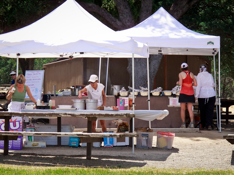 Volunteers prepare the barbeque that was waiting at the finish for all the runners.