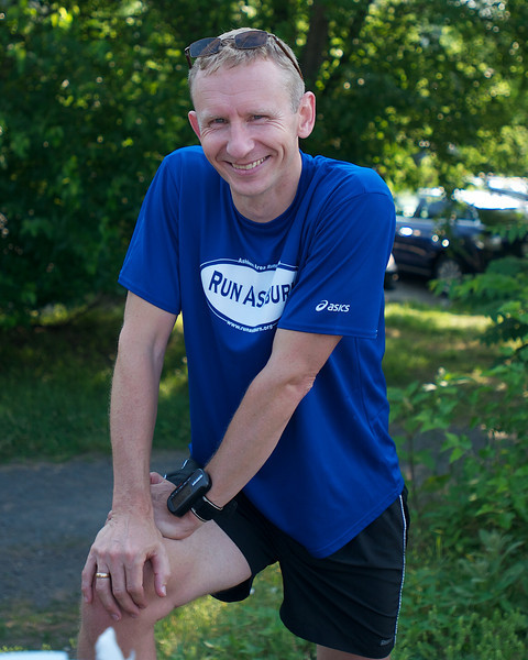 Ashburn Area Running Club Breakfast on the Trail/Distance Training Program Kickoff: Atle stretches a bit after the run
