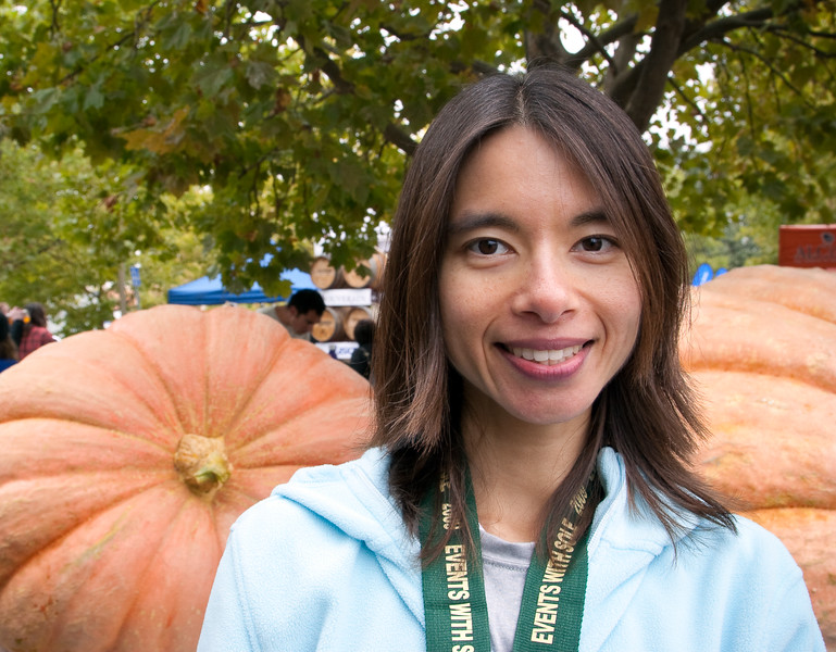 Shalimar stands in front of two giant pumpkins at the post-race festivities.