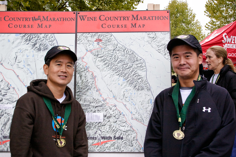 """Greg and me in front of the marathon course map. This year's course was changed from last year. The hills weren't as steep but there were a lot more of them. Total elevation gain (unofficial) was 2730 feet versus 2277 last year ( <a href=""""http://www.everytrail.com/view_trip.php?trip_id=390520"""">http://www.everytrail.com/view_trip.php?trip_id=390520</a>)."""