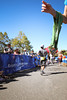 This is a pretty cool photo... I'm still running after crossing the finish line. I guess I couldn't stop after my sprint to the finish. Haha! Shalimar is cheering me on behind the blue fence on the left and the race medals are hanging on a person's arm in the foreground.
