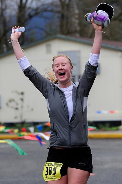 Women's 50K winner Kristin Ohm-Pedersen celebrates at the finish line.