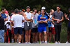 Runners prepare for the start of the 5k race. The faster runners line up at the front.