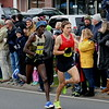 Tim True leads Paul Chelimo and holds on to tale the win  in the 80th  Thanksgiving Day Road Race.