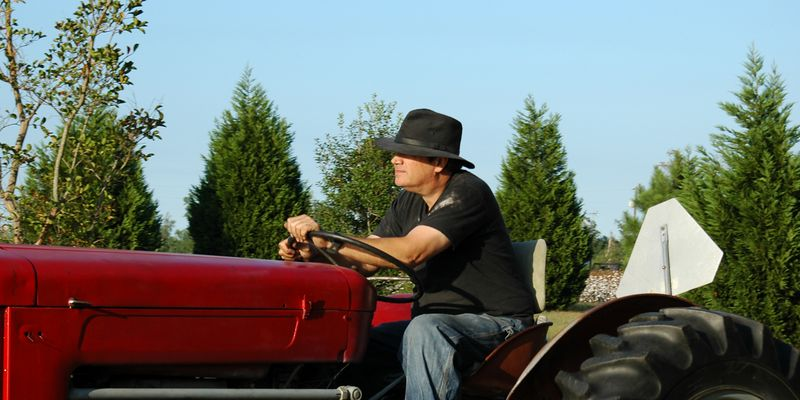EverGreene-<br /> Terry running the tractor.<br /> Our old Massey