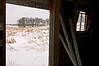 RL 025                        Looking out at the winter prairie from the interior of a barn at Glacial Park Conservation Area, Mchenry County, IL.