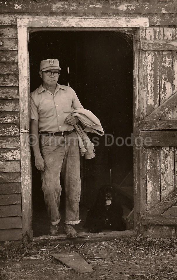 Dad and Benji at hoshouse door., Truman,MN, 1978.