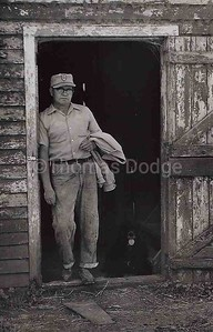 Dad in hog house doorway, ca. 1975