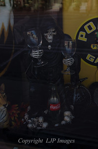 Halloween display in shop front window along Main Street in Weston, Missouri