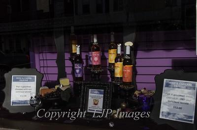 Wine display in a shop window on Main street Weston, Missouri.