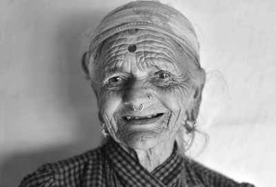 92 year old Nepalese woman Mongoli Timilsina. Abandoned by her husband after a few years of their arranged marriage she was never allowed to be with another man. Such is the tradition in Nepal and India. One arranged partner for life and zero pre marital relationships. Although these traditions are now showing signs of flexibility. Most of the Nepali people that I spoke to did not like the idea of our western system allowing multiple partners throughout our life.