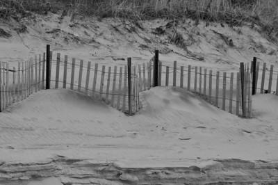 Sand, fence, dunes