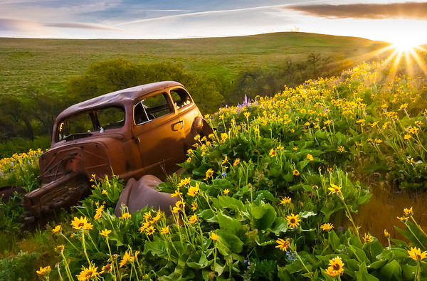 Rusted Car at Sunset
