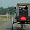 Amish man and woman in buggy.  Copyright - W. Keith Baum | PhotoCanal.com