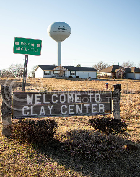 A welcome sign stands at a road leading into Clay Center. (Madeline Emerson | Collegian Media Group)