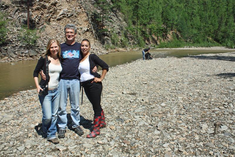 Alice, Wafaa & Rustem by the riverside in the Amur Region's taiga.