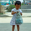 Little girl with her shopping bag in Heihe.