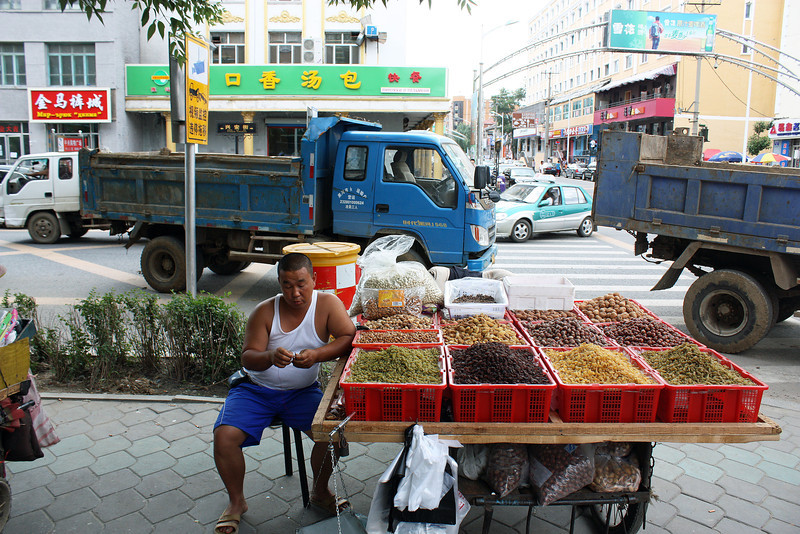 Selling nuts & dried fruits on the street in Heihe.