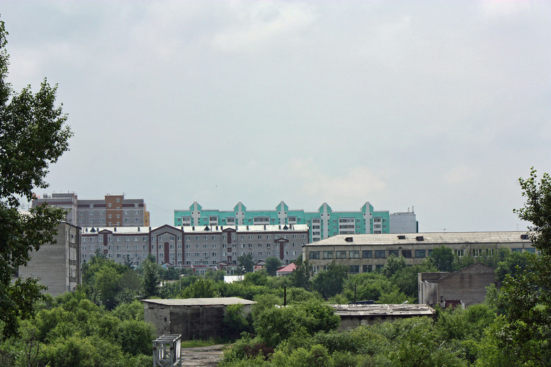 The blue buildings in the distance are apartments built by Li Lihua.