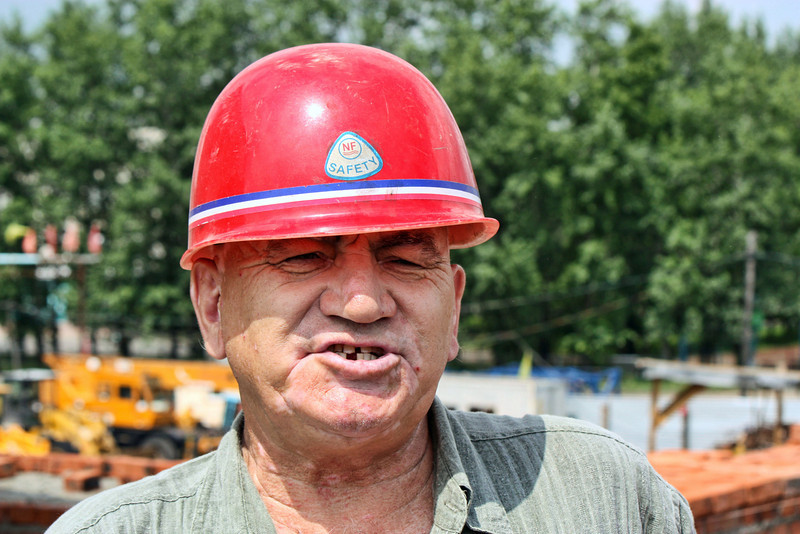 Hard hat. Li Lihua's construction manager. He came to the region decades ago to help build the Baikal-Amur Railway & was commended as a Hero of Soviet Labor.