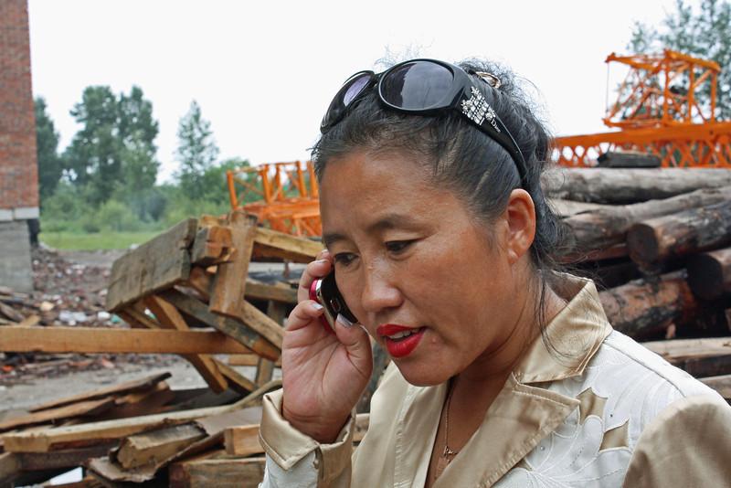 Li Lihua - a busy woman on the phone.