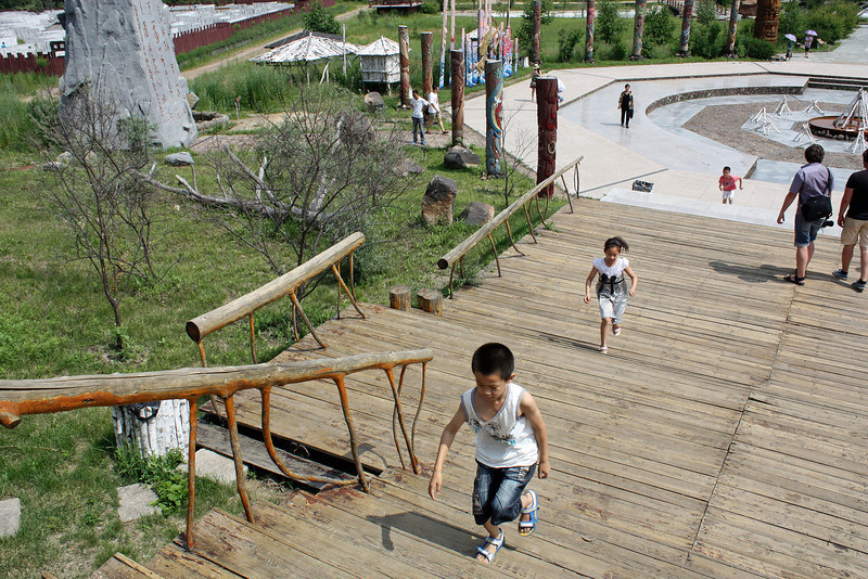 Kids racing up the stairs in Heihe's Ethnographic Museum.